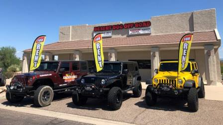3 jeep wranglers with rental flags