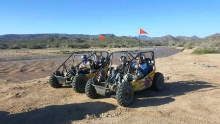 2 sand buggies next to an AZ river