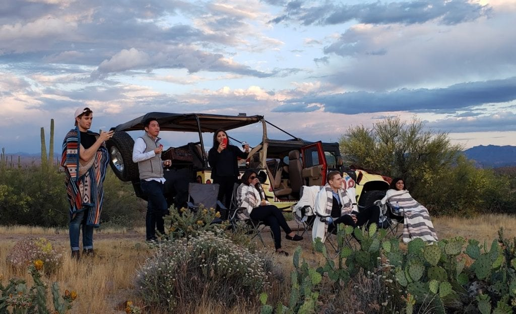 group watching an AZ sunset during a hummer tour